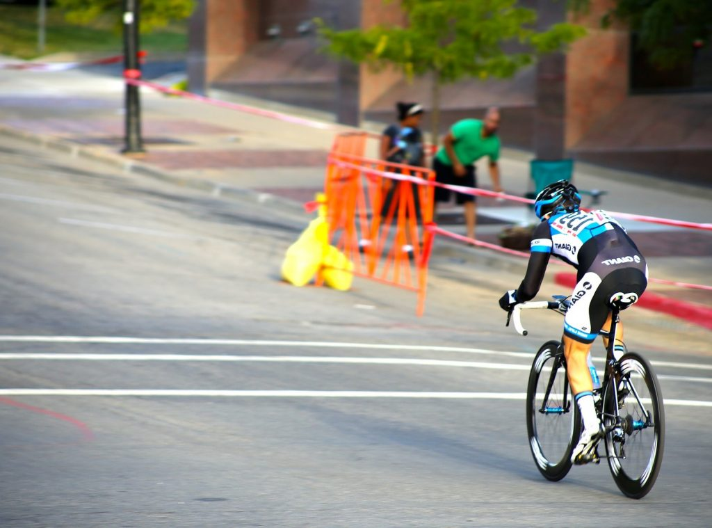 athlete on bicycle racing uphill