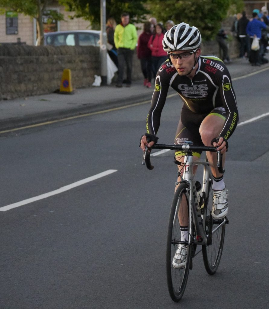 cyclist clipped into the pedals for extra power during a road race
