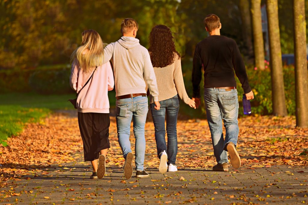 two couples walking in the beautiful Elderbrook Park